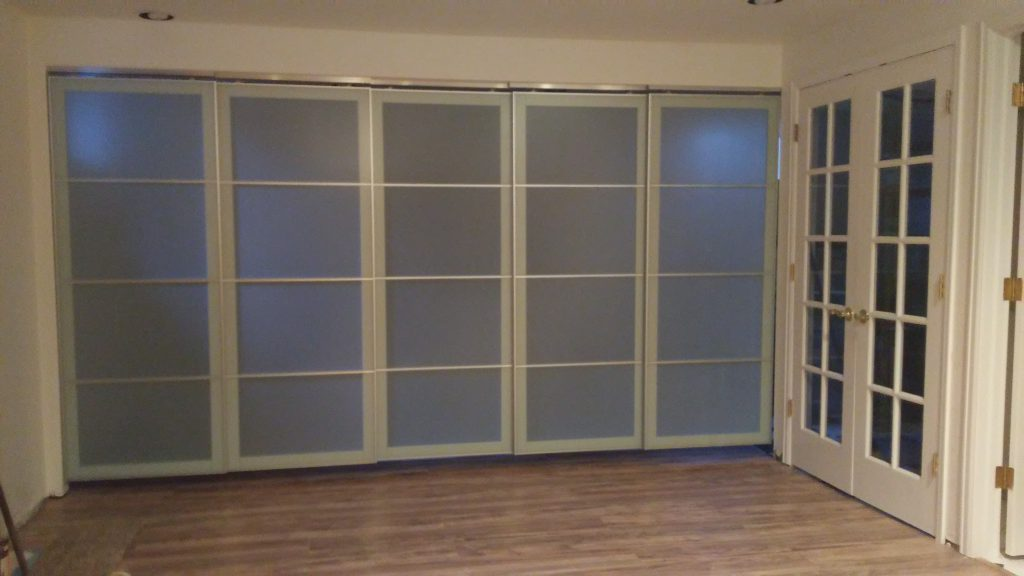 John Hurdel of Longmont, Boulder County, Colorado uses these Ikea door panels to create a sliding wall and room divider in Gunbarrel, Colorado.