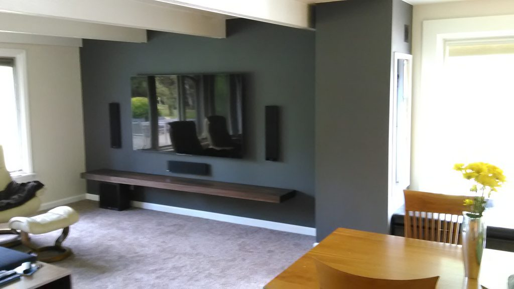 John Hurdel created this minimalist entertainment center with walnut mantel in Boulder, Colorado 80301.