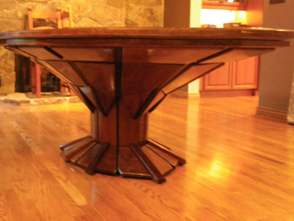 John Hurdel, Longmont, Boulder County, Colorado carpenter and furniture designer, designed and built this multifaceted 5' x 8' walnut, oval dining table for the Sullivan family in Littleton, Colorado.